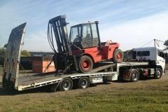 Forklift transport by trailer truck