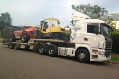 Transporting a yellow and red forklift