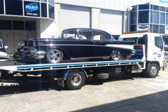 Truck transport of old classic car