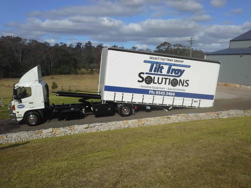 Race car transport with tilt tray truck